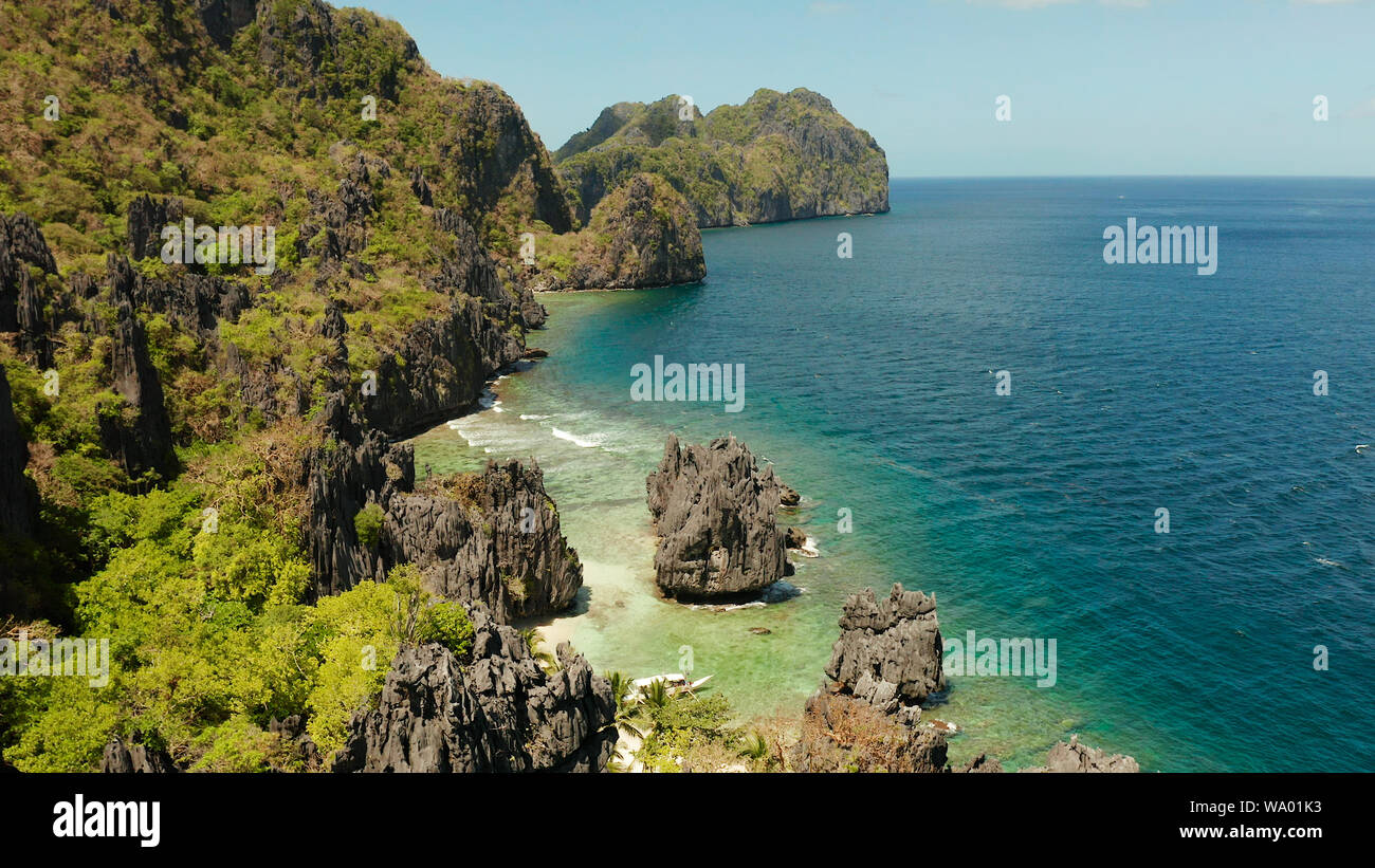 Tropical Lagoon With Sandy Beach Surrounded By Cliffs El