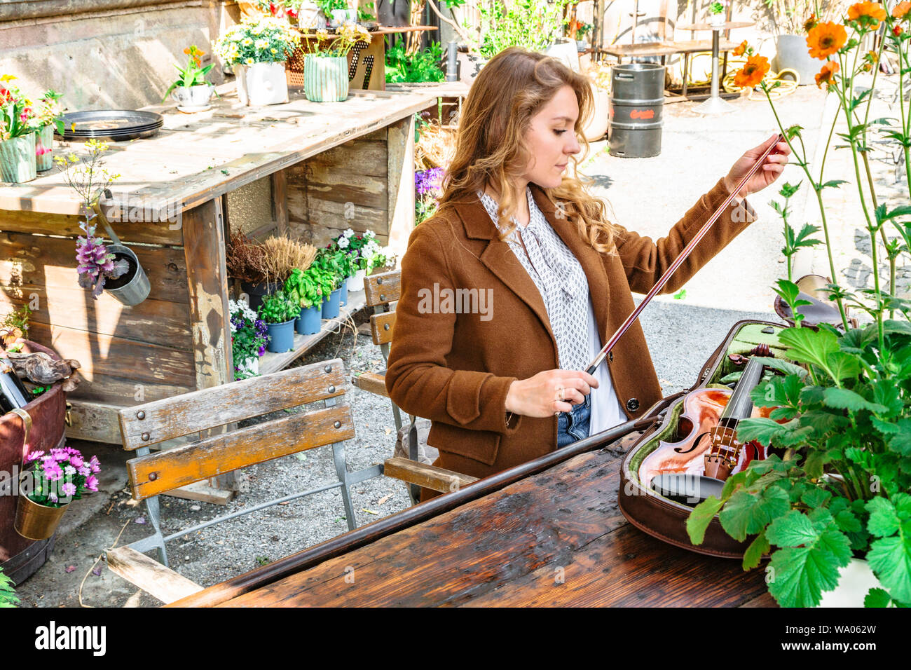 Young girl holding bow for playing violin in hands Stock Photo