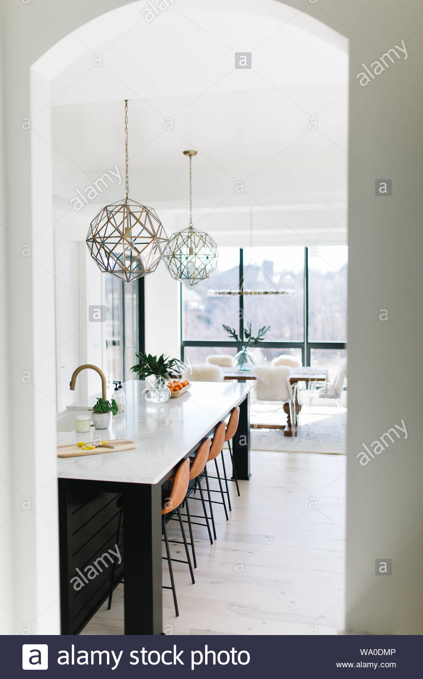 two pendant lamps under kitchen island Stock Photo ...