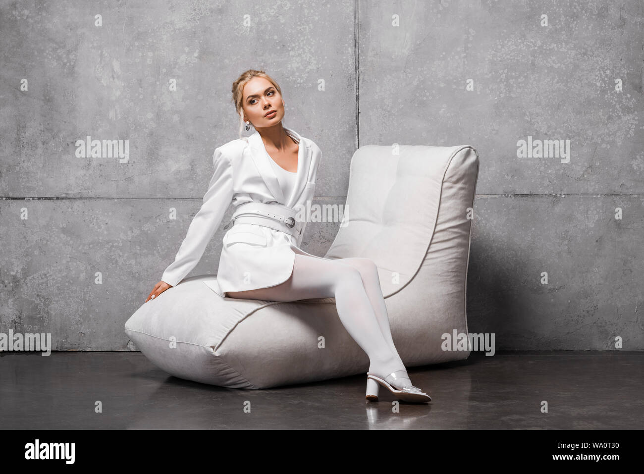 Magnificent Beautiful Blonde Woman Sitting On Soft Bean Bag Chair On Andrewgaddart Wooden Chair Designs For Living Room Andrewgaddartcom