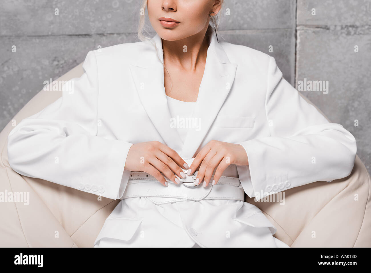 Excellent Cropped View Of Woman Sitting On Soft Bean Bag Chair On Grey Andrewgaddart Wooden Chair Designs For Living Room Andrewgaddartcom