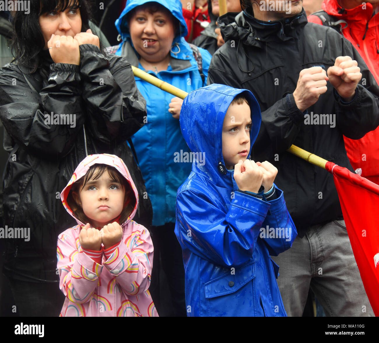 Manchester., UK. 16th Aug, 2019. Neneh aged 4 and brother Liam 8, show solidarity with the crowd at the Peterloo massacre memorial event at Manchester Central. © copyright Credit: Della Batchelor/Alamy Live News Stock Photo