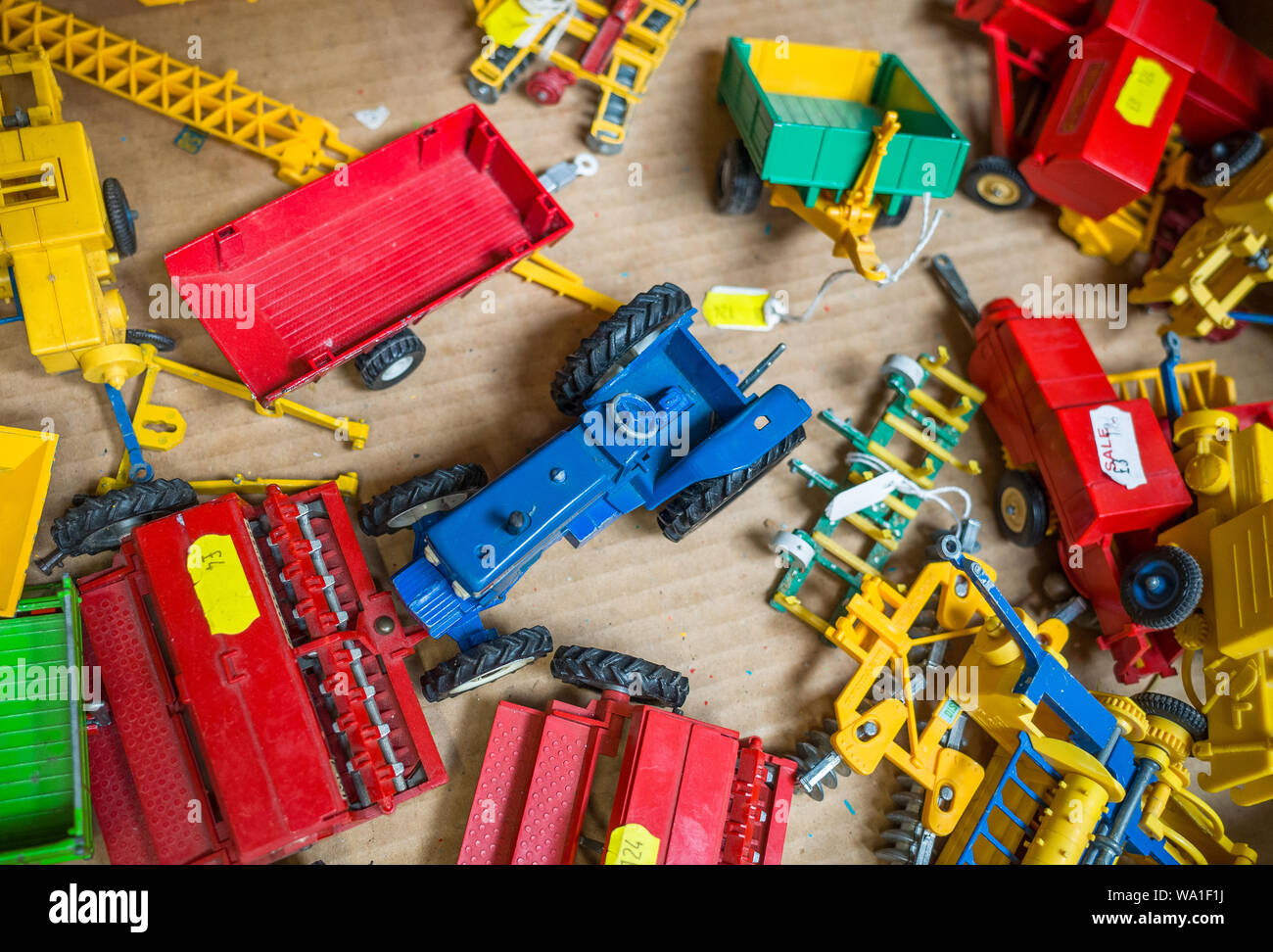 Old diecast farm vehicles for sale in a box. Stock Photo
