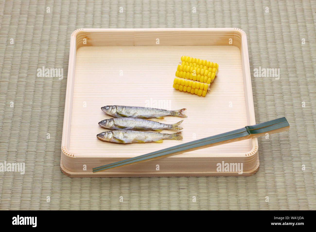 Hassun, assorted tidbits for Japanese tea ceremony cuisine on tatami mat. Stock Photo
