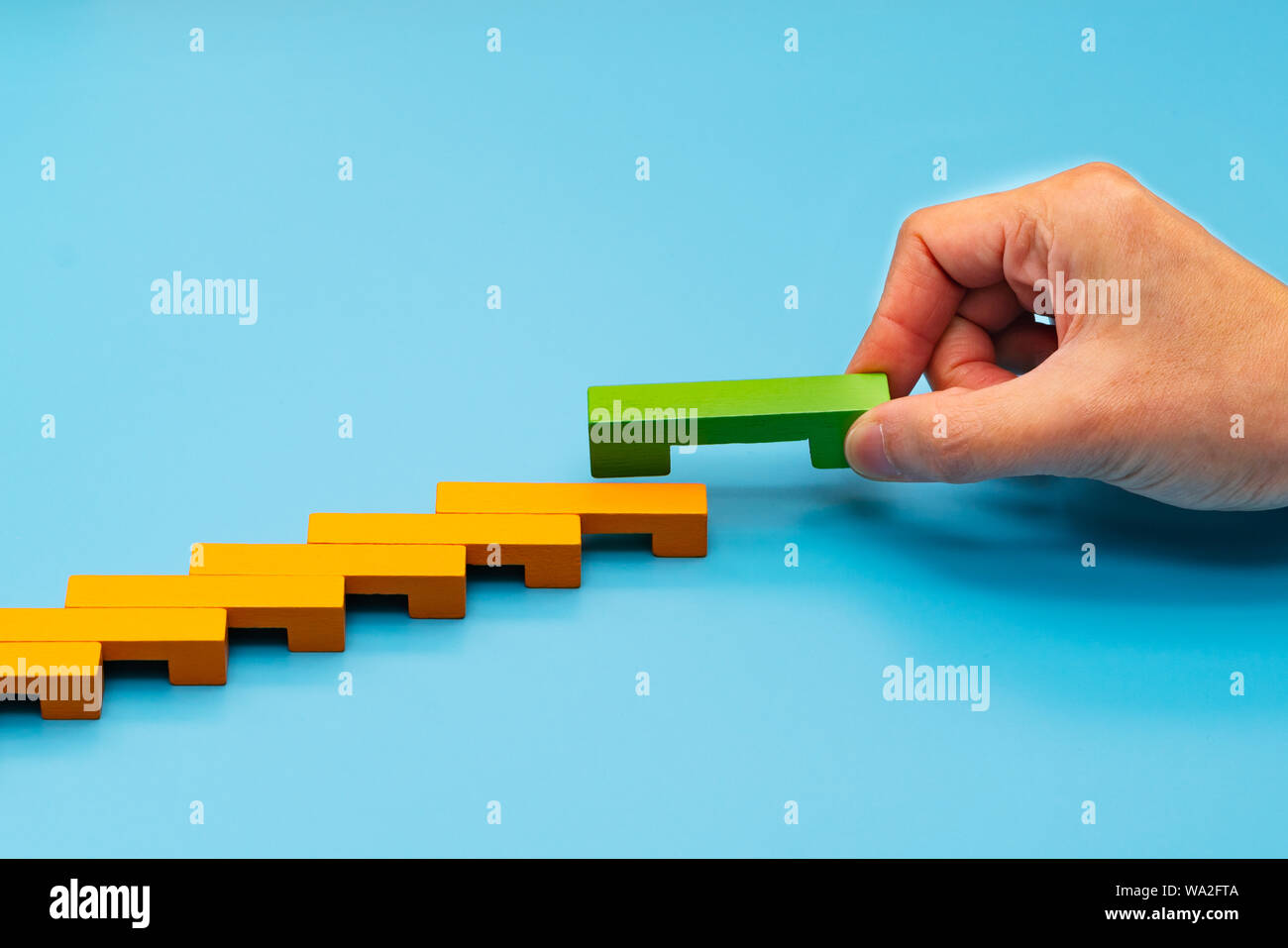 Business concept for growth success process, hand stacking wood block as step stair Stock Photo