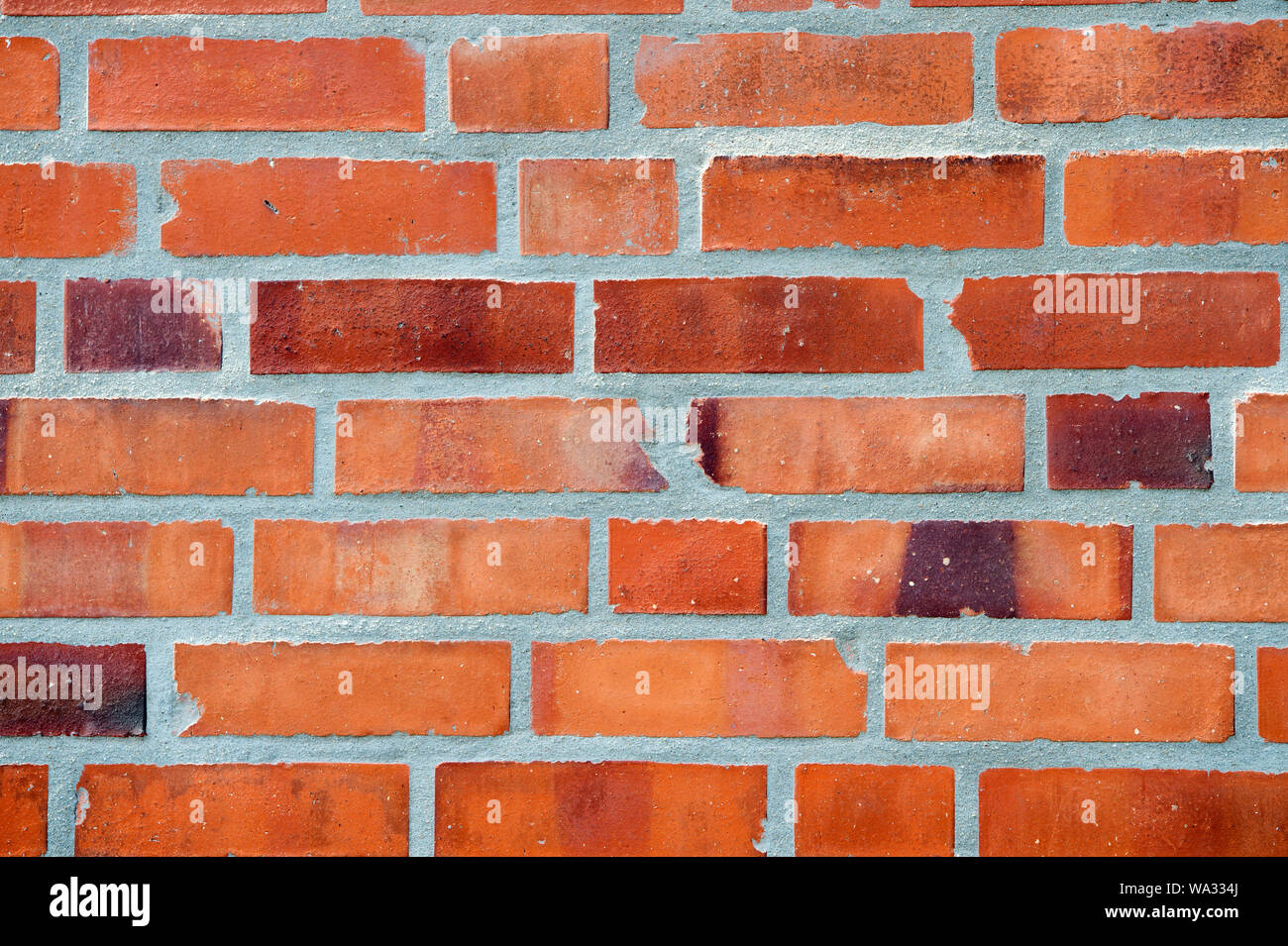 Decor and design. Red brick wall texture background. Industrial background empty grunge urban warehouse brick wall. Building material concept. Surface on masonry background. Abstract backdrop. Stock Photo