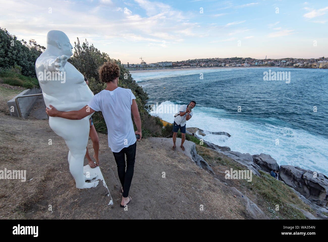 People interacting with exhibits at 20th Sculpture by the Sea exhibition in November 2016 at Sydney's Bondi Beach in Australia Stock Photo
