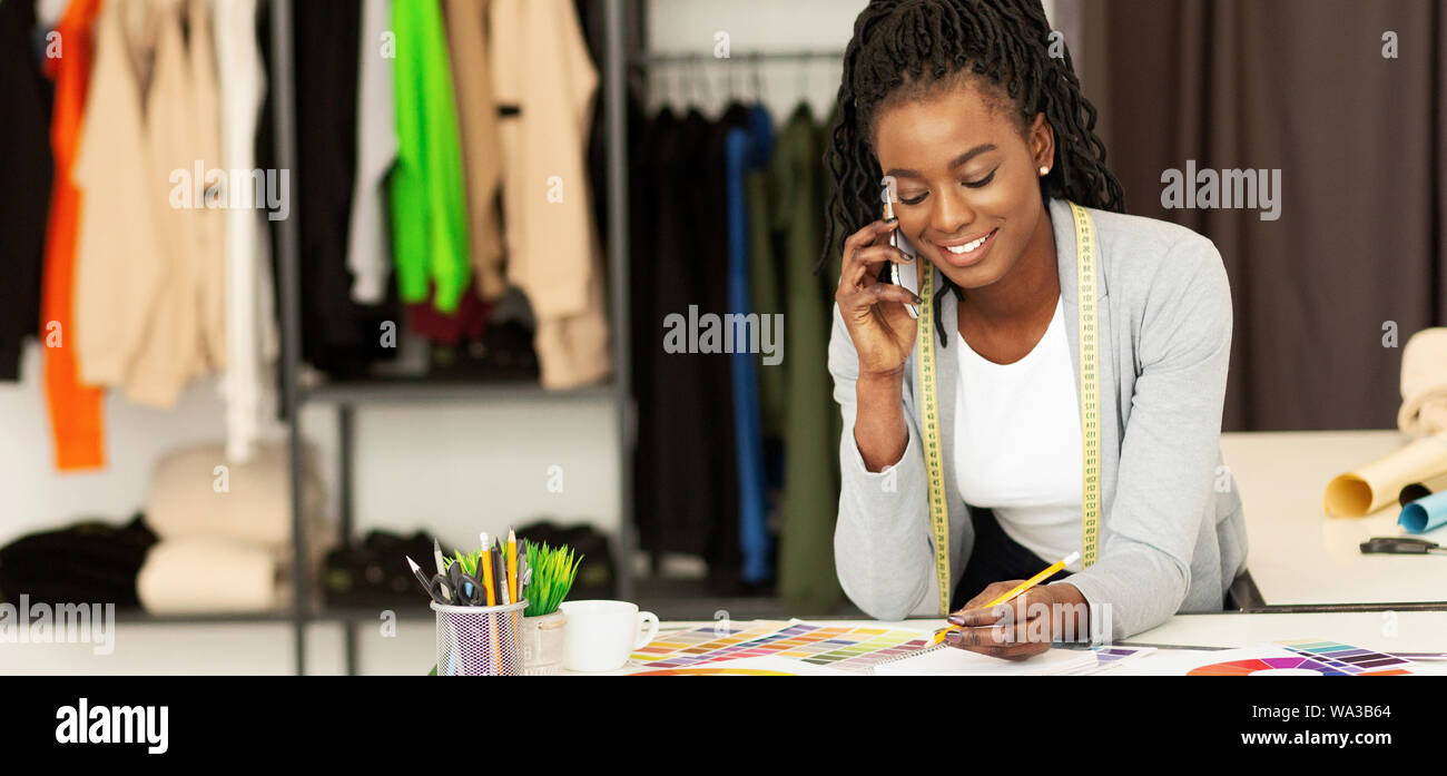 African American Fashion Designer Receiving Phone Order In Studio Stock Photo Alamy