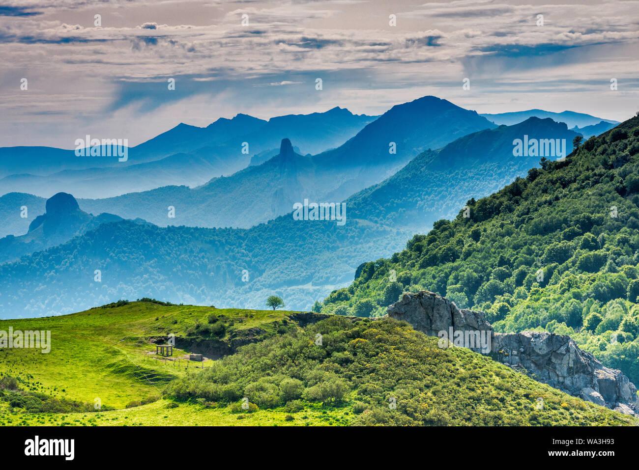 Cordillera Cantabrica distant mountain ranges, view from Mirador del Corzo on road N621 over Valle de Cereceda, Picos de Europa, Cantabria, Spain Stock Photo