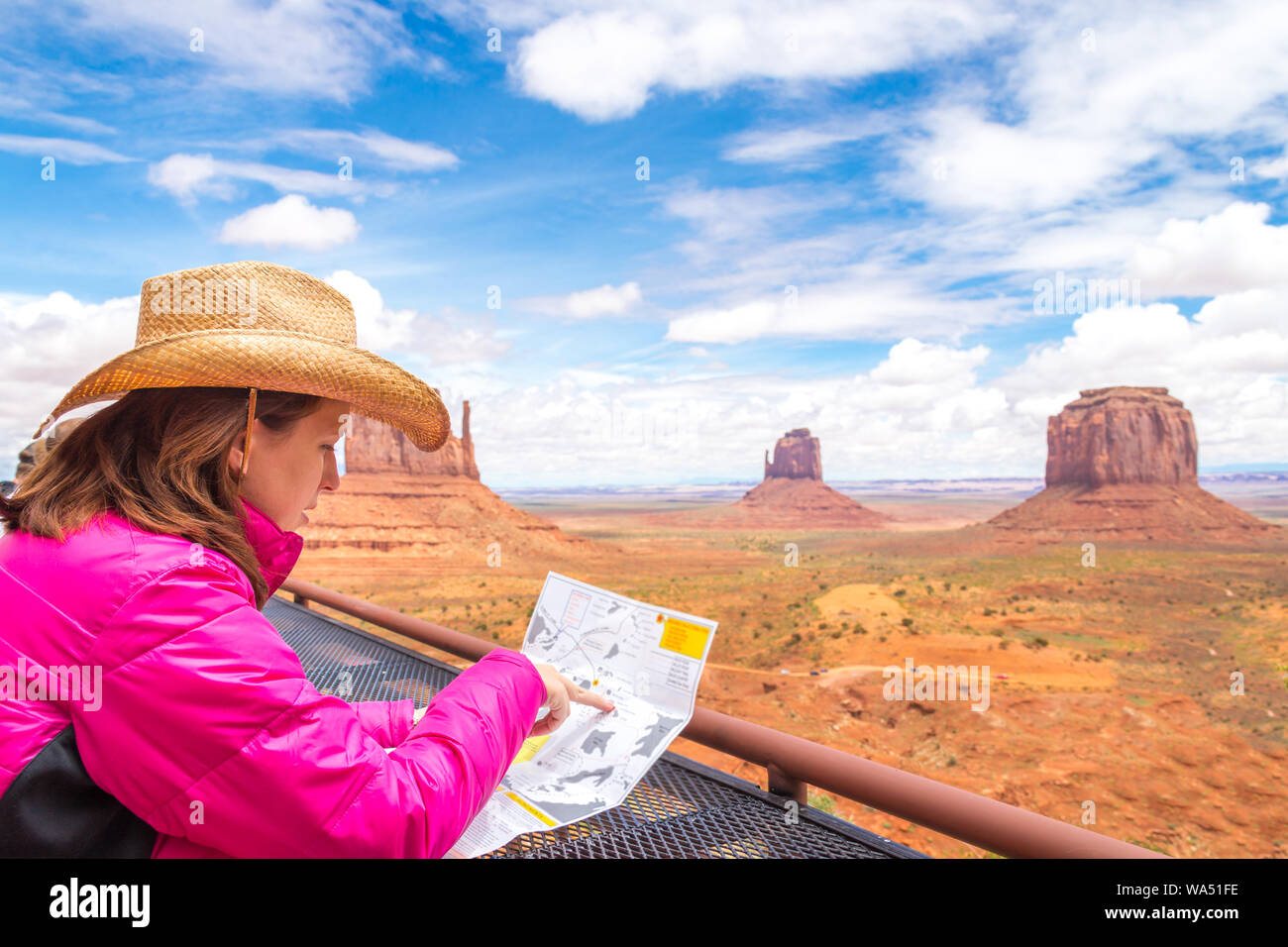 Map Of Arizona Monument Valley.Woman Wearing Cowboy Hat Sitting And Looking At Map In Monument