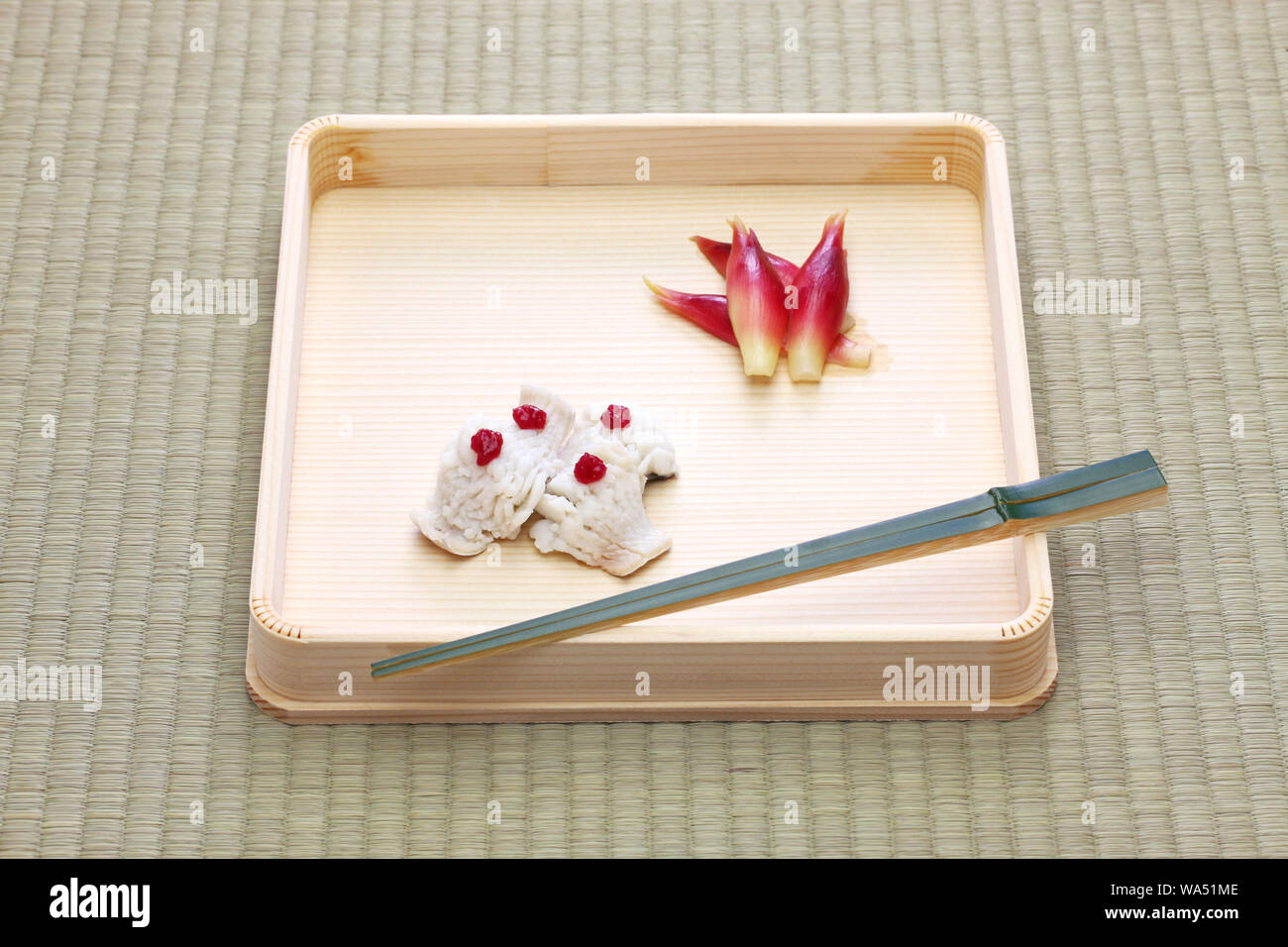 Hassun, assorted tidbits for Japanese tea ceremony cuisine on tatami mat. Stock Photo
