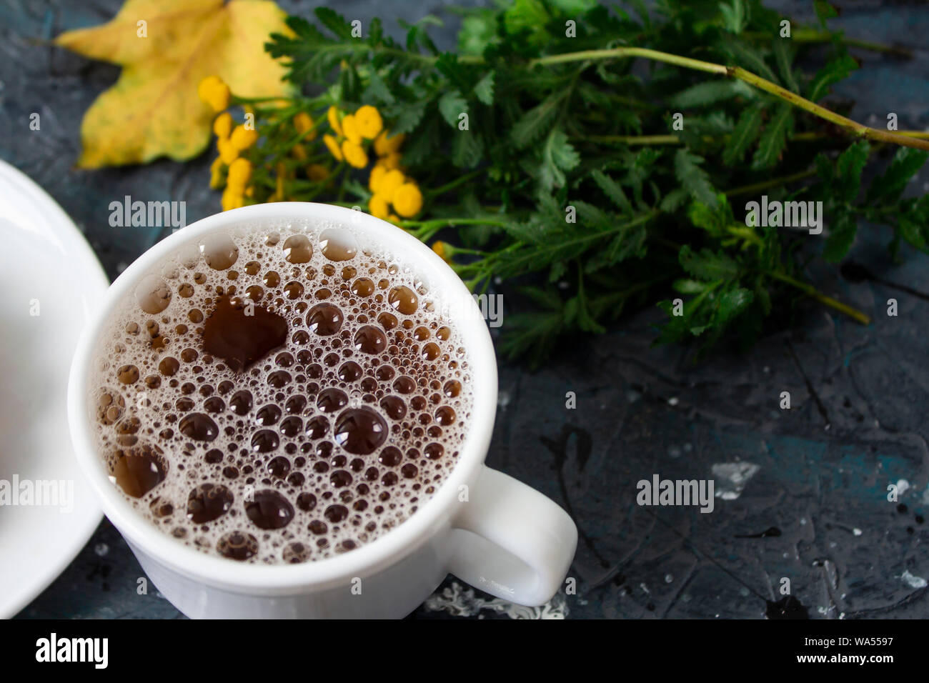 Tea. green Tea. Herbal tea. Mint leaf. Tea with apple flavor. Tea in a glass cup with apple blossoms and leaves dried tea sliced lime. herbs tea and m Stock Photo