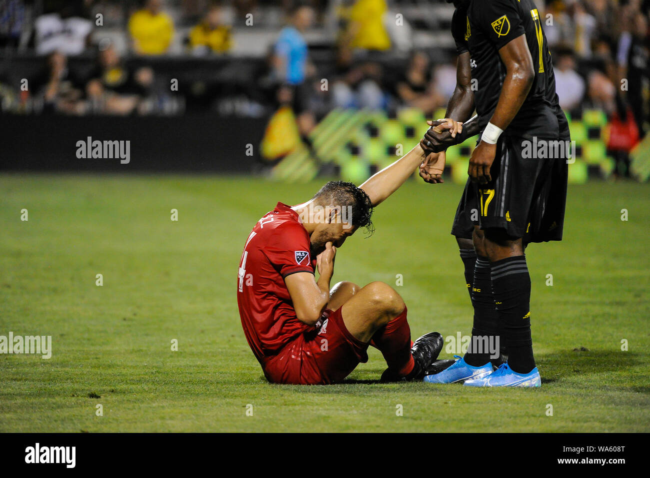 Saturday, August 17, 2019: Toronto FC defender Omar Gonzalez (44) is helped up in the second half of the match between Toronto FC and Columbus Crew SC at MAPFRE Stadium, in Columbus OH. Mandatory Photo Credit: Dorn Byg/Cal Sport Media. Toronto FC 2 - Columbus Crew SC 2 at the end of the first half. Stock Photo