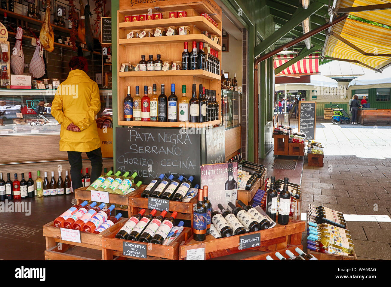 MUNICH, GERMANY- AUGUST 16, 2019 Gourmet food and wine shop offers international specialties and Bavarian delicacy at Viktualienmarkt, Munich landmark Stock Photo