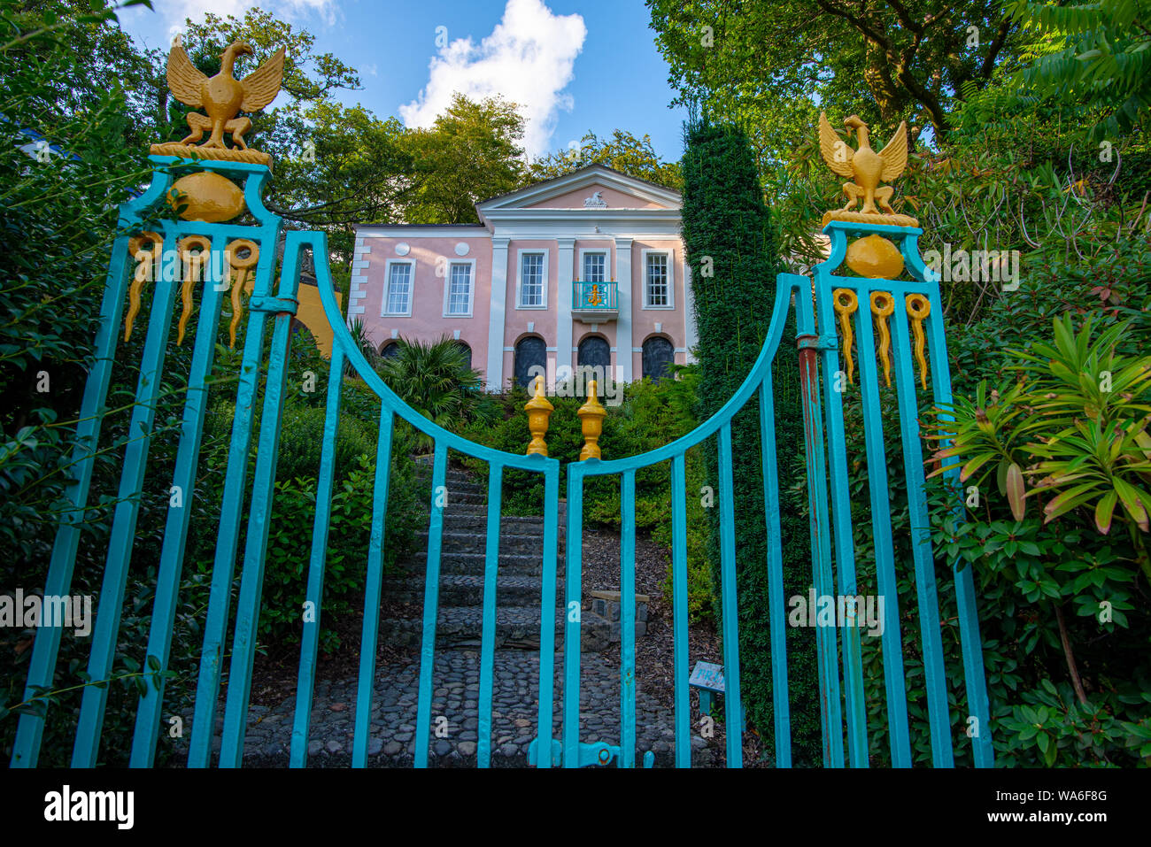 Penrhyndeudraeth, Wales, UK - Aug 15, 2019: Palladian inspired building at the Portmeirion village and pinned steel gate with no people Stock Photo