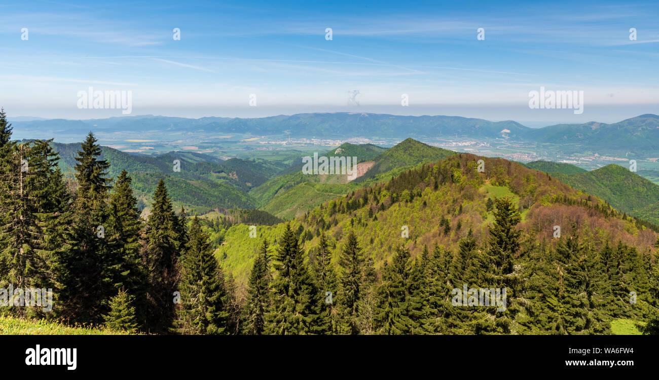 Whole Lucanska Mala Fatra and part of Krivanska Mala Fatra mountains with Turiec river valley bellow from Koskarovska luka meadow bellow Klak hill in Stock Photo