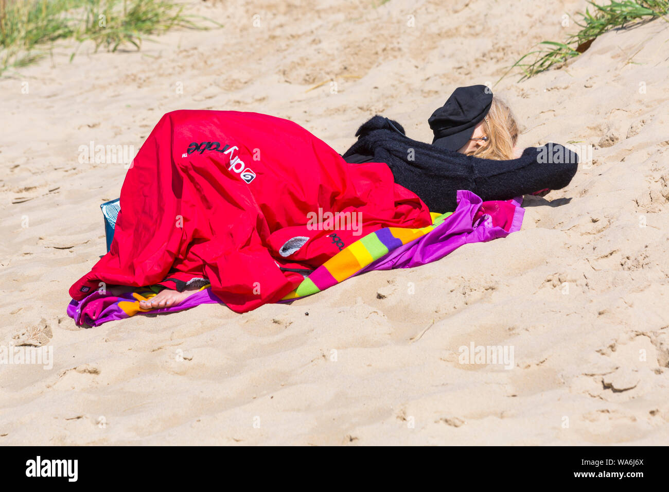 Poole, Dorset UK. 18th Aug 2019. UK weather: after a wet start, the sun returns and a lovely warm sunny day as beachgoers head to the seaside at Poole beaches to enjoy the sunshine. Credit: Carolyn Jenkins/Alamy Live News Stock Photo