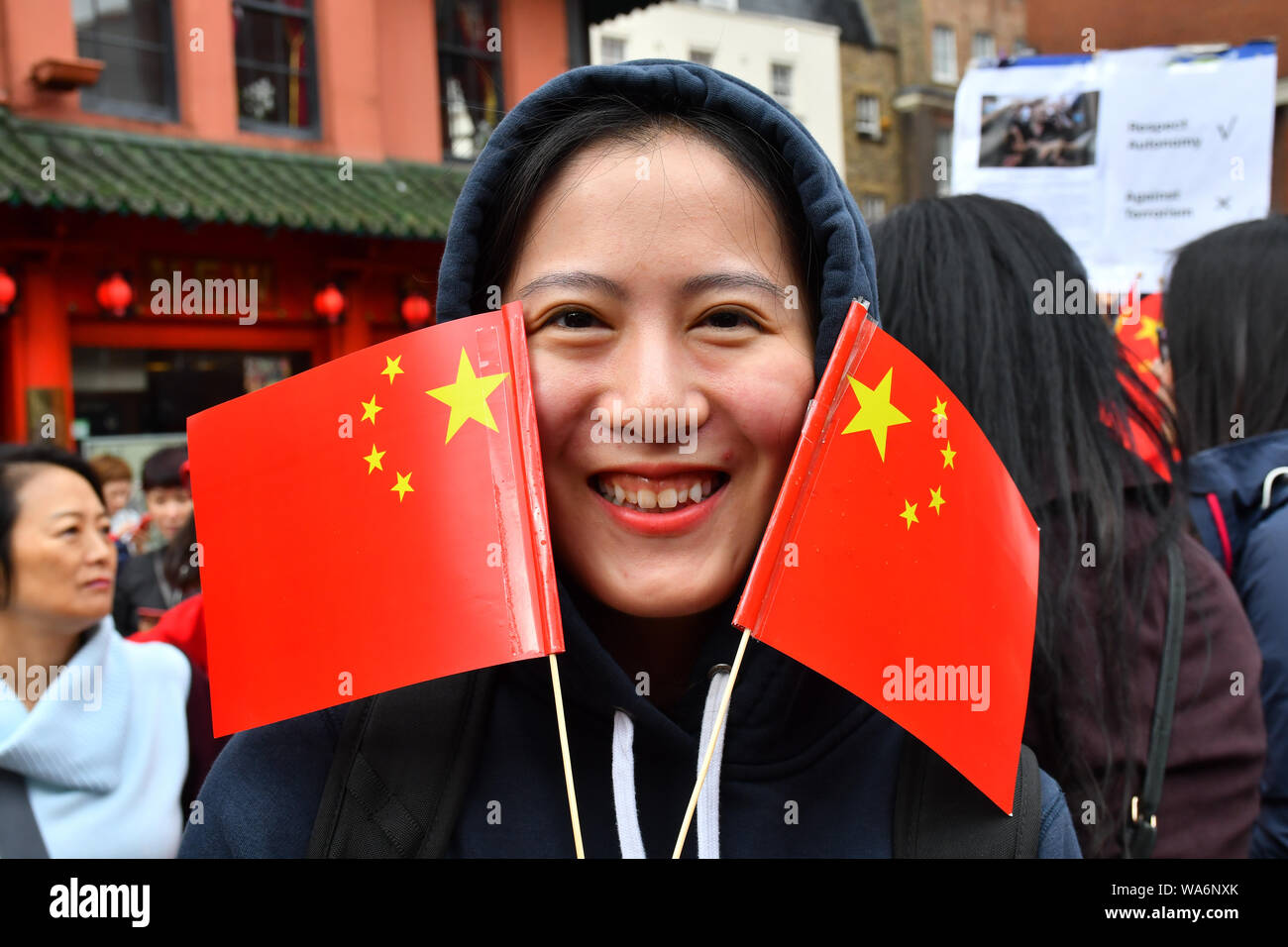 """London, UK. 18 August 2019. Hundreds of Pro-China and Pro-HK united """"We love China - We Love HK"""" to supports HK police assembly in London Chinatown march to Trafalgar Square anti-violence and restore peace in HK, singing China national anthem along the way and all the criminal must be punished by the rule of law. In fact, Since the HK protests and the western propaganda media backfire each day China growing supporters from all world and oversea born Chineseand your self consciousness. Credit: Picture Capital/Alamy Live News Stock Photo"""