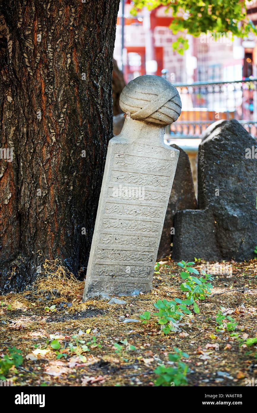 Historical Ottoman tombstones in a graveyard at Hamamonu, Ankara, Turkey. Stock Photo