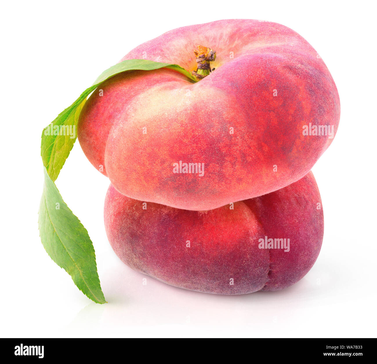 Isolated fruits. Two flat peaches (doughnut peaches) on top of each other isolated on white background with clipping path Stock Photo