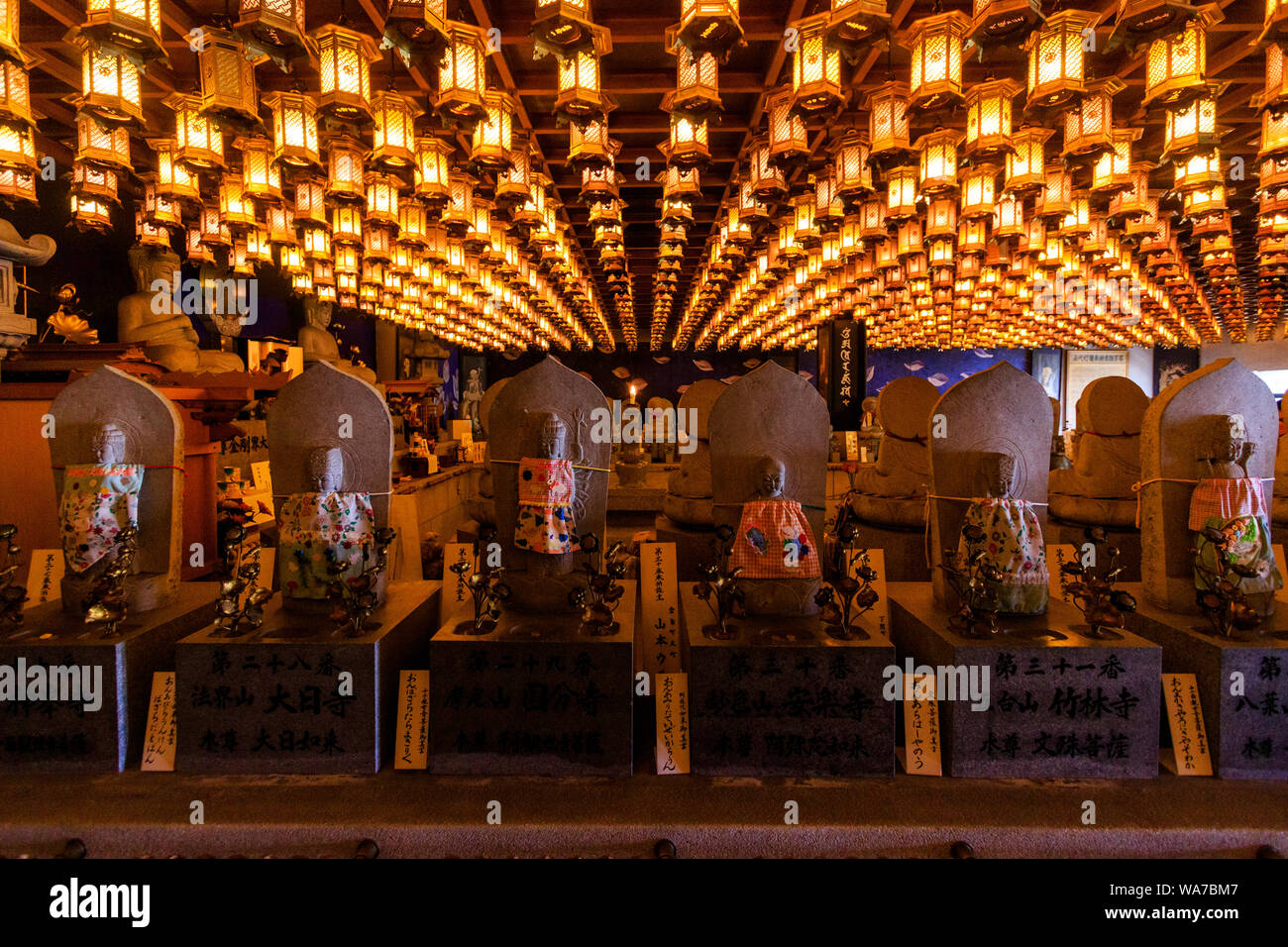 Japan, Miyajima. Daisho-in temple. Interior, Henjokutsu Cave housing the principal icons of 88 temples. Hall lit by hundreds of hanging hexagon lights. Stock Photo