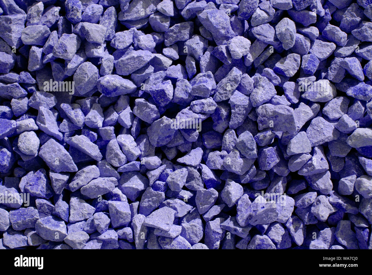 violet dyed stones for background texture in the sun Stock Photo