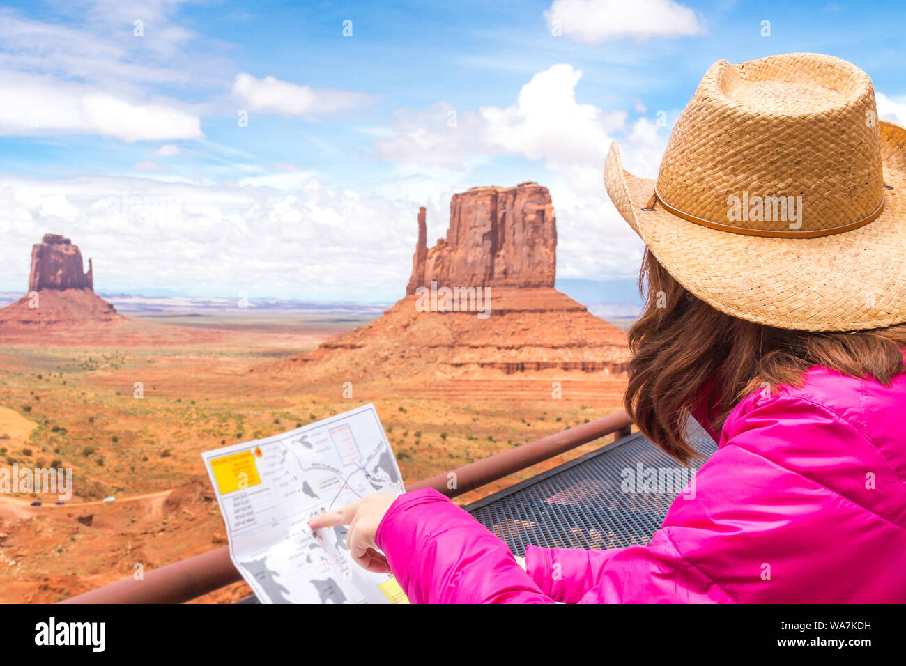Map Of Arizona Monument Valley.Woman Sitting And Looking At Map In Monument Valley With Red Rocks