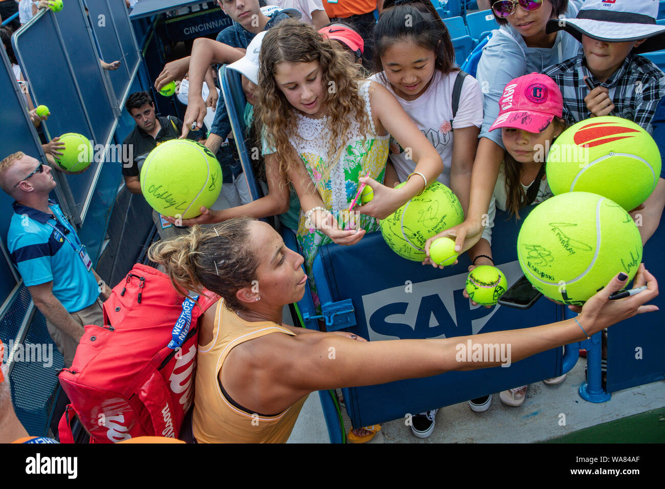 August 18, 2019, Mason, Ohio, USA: Madison Keys (USA) signs autographs for fans after winning the Women's Final of the Western and Southern Open at the Lindner Family Tennis Center, Mason, Oh. (Credit Image: © Scott Stuart/ZUMA Wire) Stock Photo