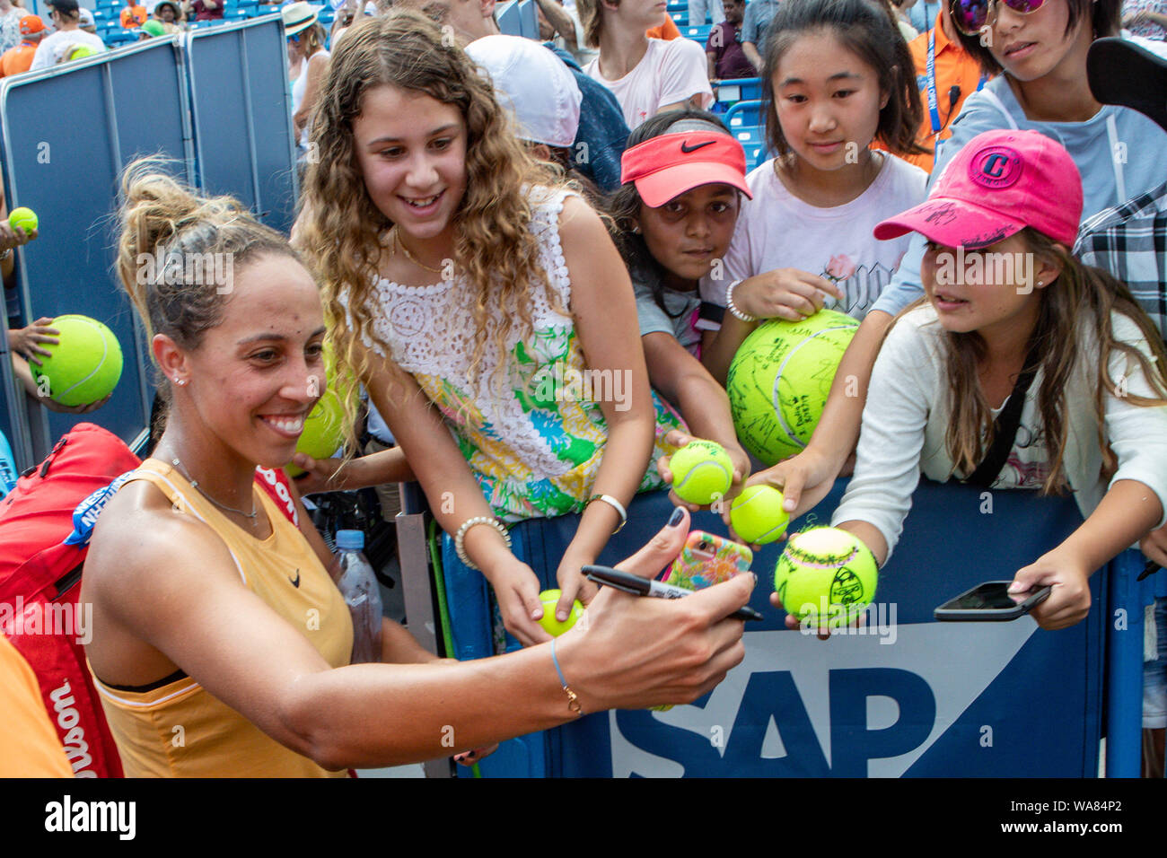 August 18, 2019, Mason, Ohio, USA: Madison Keys (USA) poses for a selfie with fans after winning the Women's Final of the Western and Southern Open at the Lindner Family Tennis Center, Mason, Oh. (Credit Image: © Scott Stuart/ZUMA Wire) Stock Photo