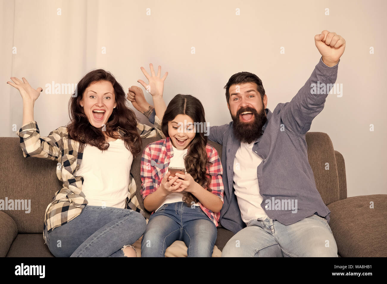 Child Little Girl Use Smartphone With Parents Friendly Family