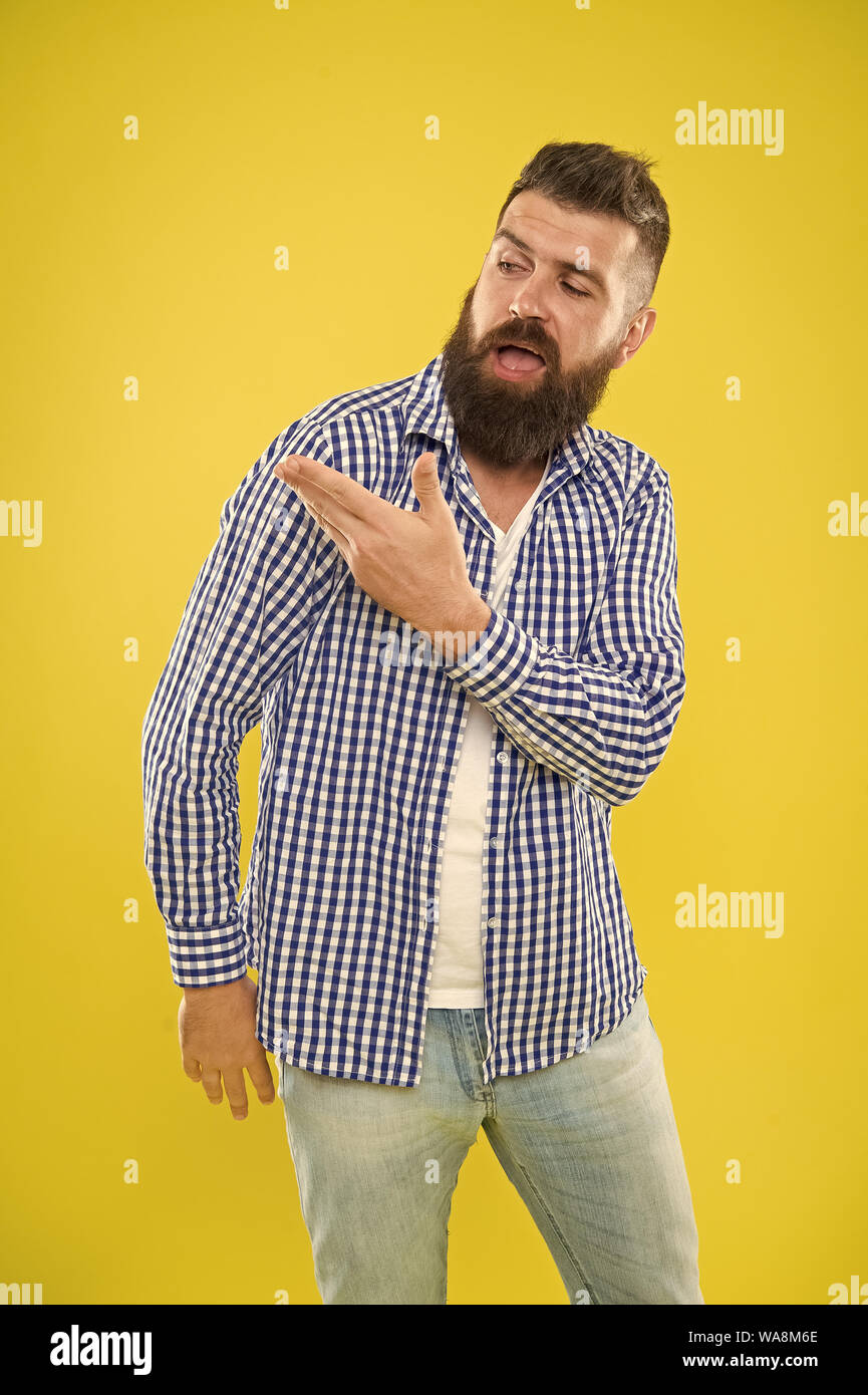 Angel on my shoulder. Beard fashion and barber concept. Man bearded hipster beard yellow background. Barber tips maintain beard. Beard mustache care. Hipster appearance. Emotional expression. Stock Photo