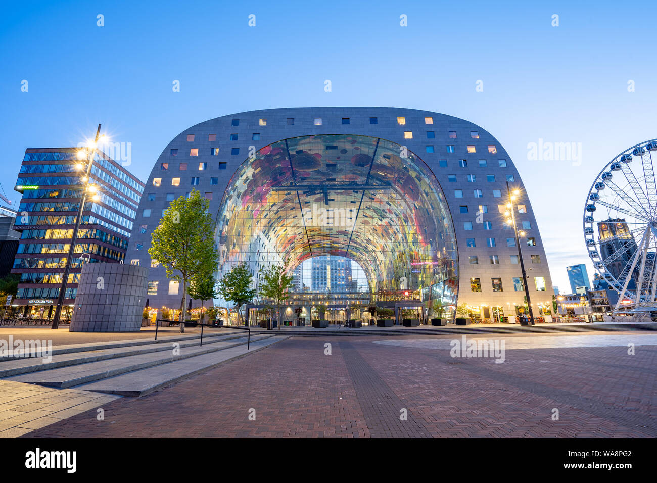 Rotterdam, Netherlands - May 13, 2019: The Markthal at night in Rotterdam city, Netherlands. Stock Photo
