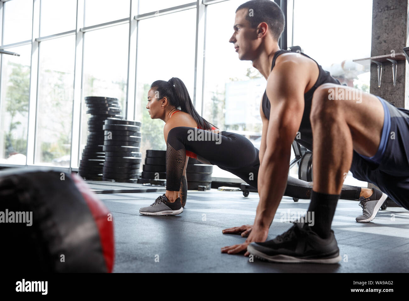 A Muscular Athletes Doing Workout At The Gym Gymnastics Training Fitness Workout Flexibility Active And Healthy Lifestyle Youth Bodybuilding Training In Lunges And Stretching Exercises Stock Photo Alamy