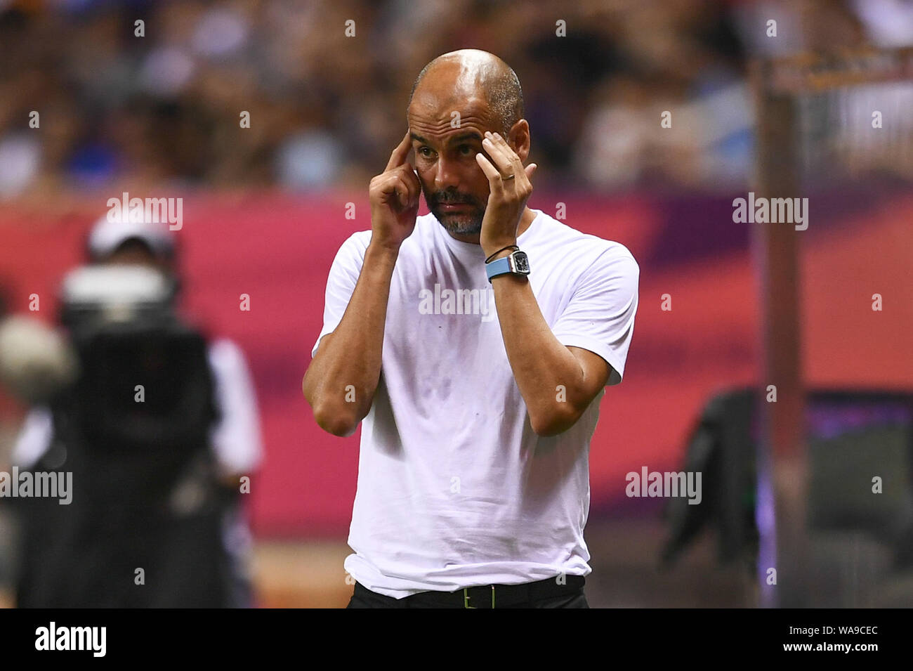 Head coach Pep Guardiola of Manchester City F.C. of English League champions shouts instructions to his players as they compete against Wolverhampton Stock Photo