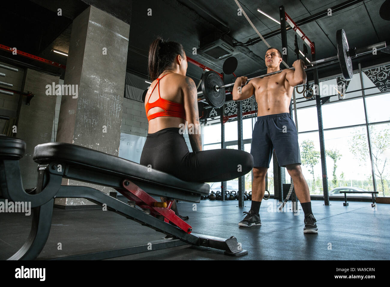A muscular athletes doing workout at the gym  Gymnastics