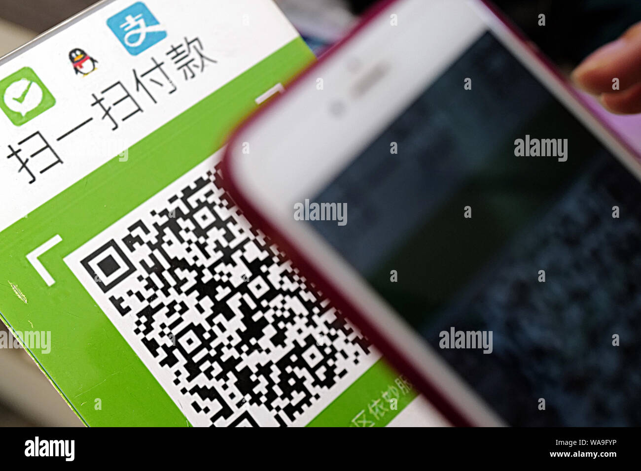 FILE--A Chinese mobile phone user scans a QR code via mobile