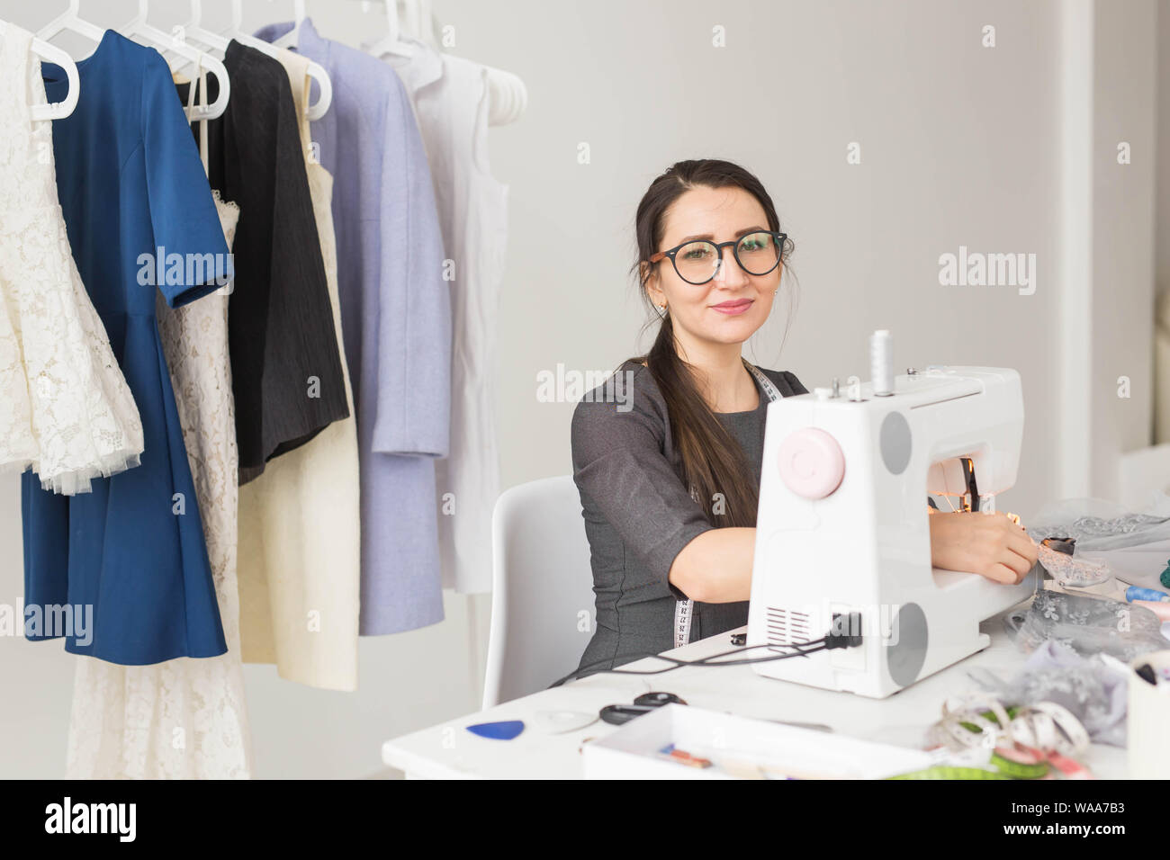 People Dressmaker Tailor And Fashion Concept Young Fashion Designer In Her Showroom Stock Photo Alamy