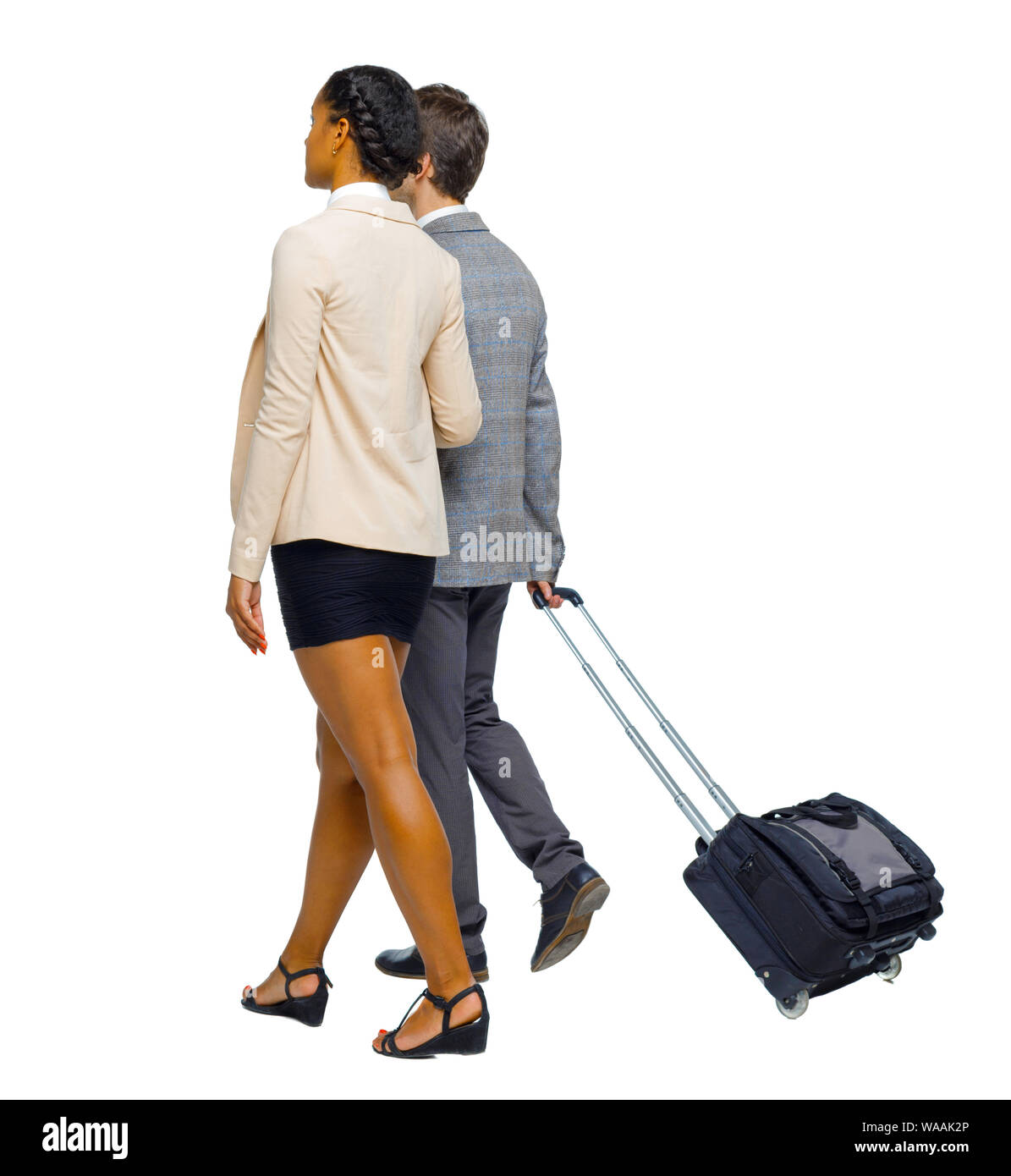 Back view of interracial going couple with suitcase. Rear view people collection. backside view of person. Isolated over white background. Young busin Stock Photo