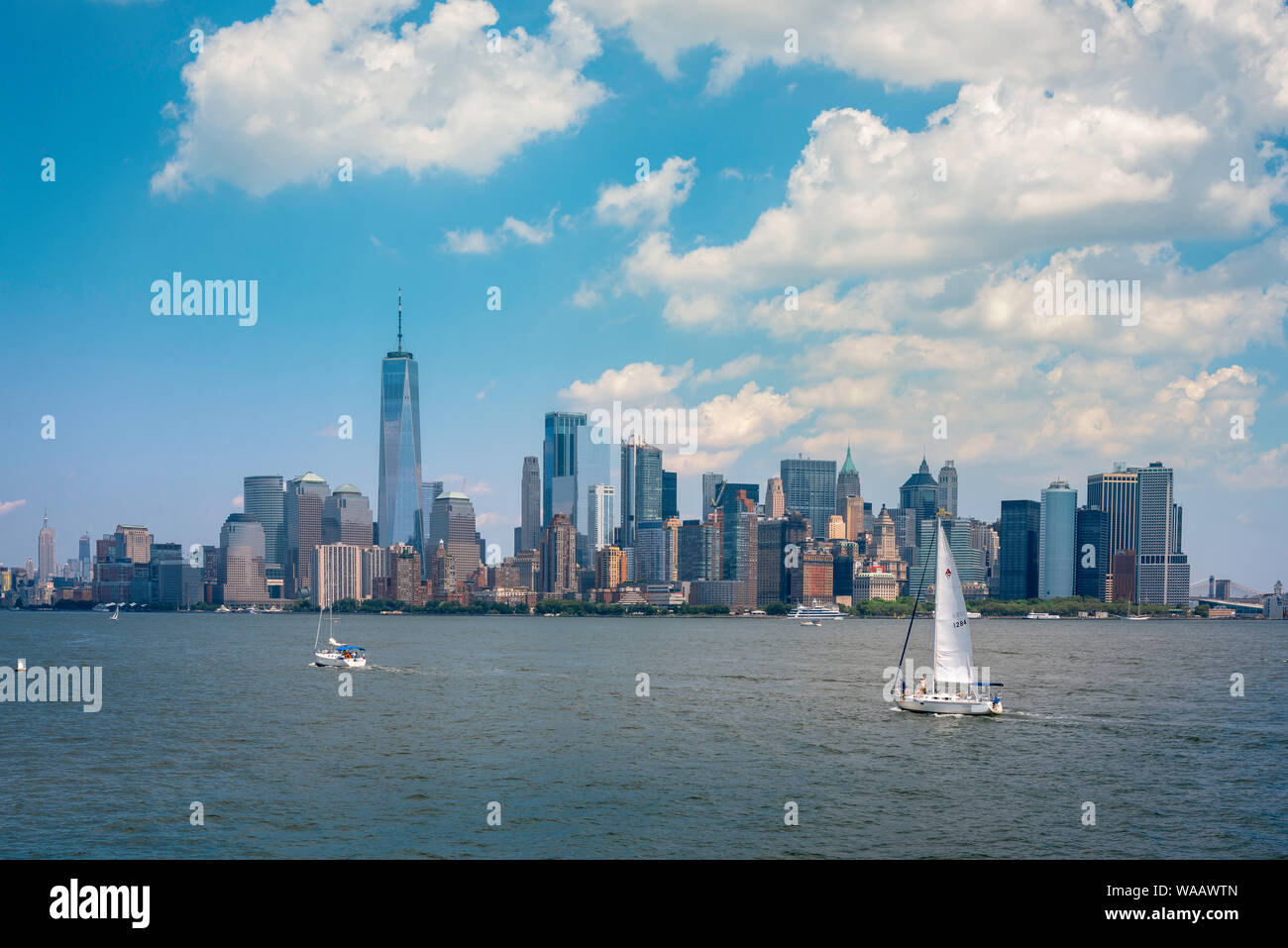 New York City lifestyle, view in summer of New Yorkers sailing their yachts  in the Lower Manhattan bay area, New York City, USA. Stock Photo