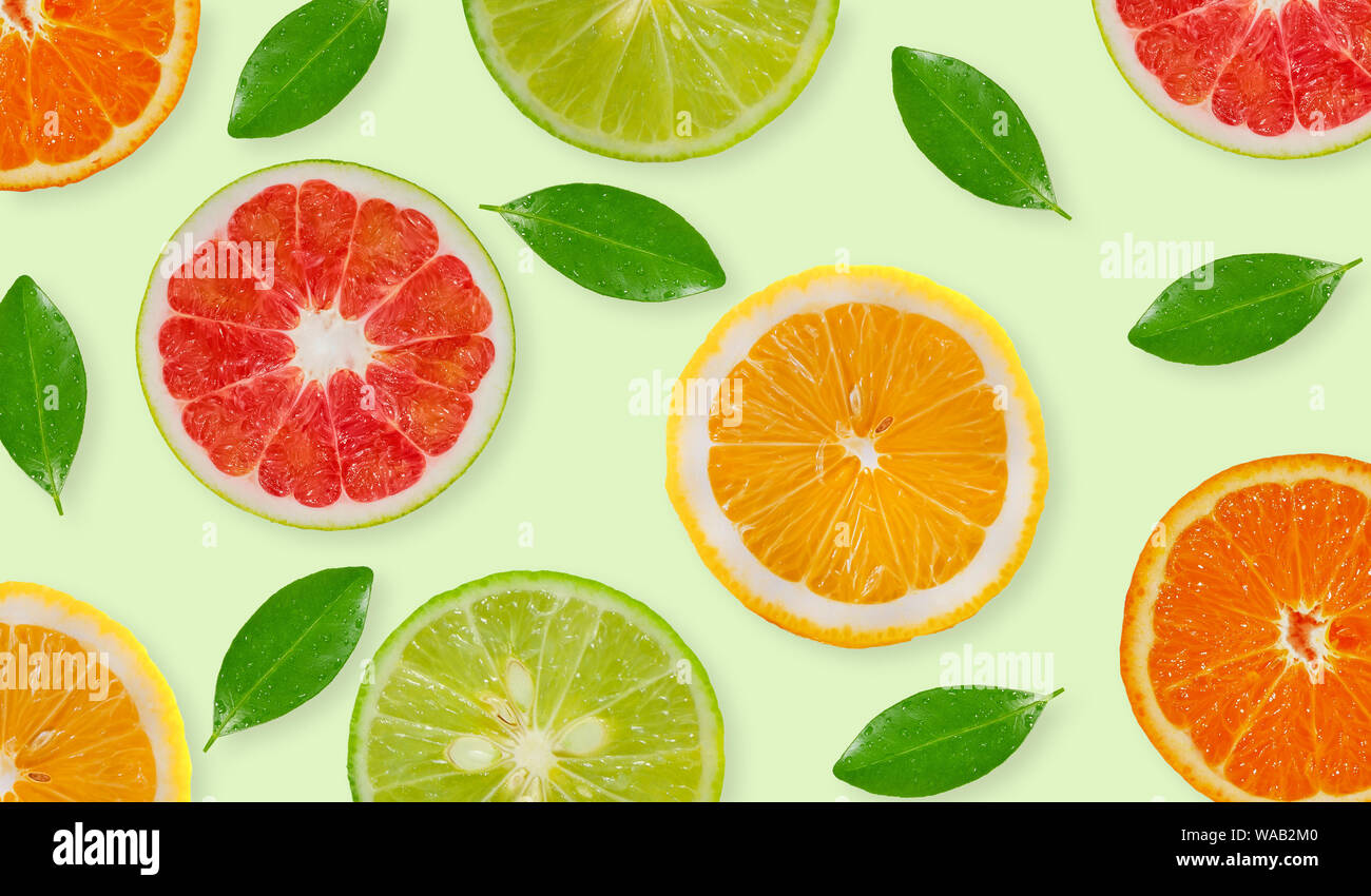 Variety of whole and sliced citrus fruits , lemon, lime,grapefruit and orange Stock Photo