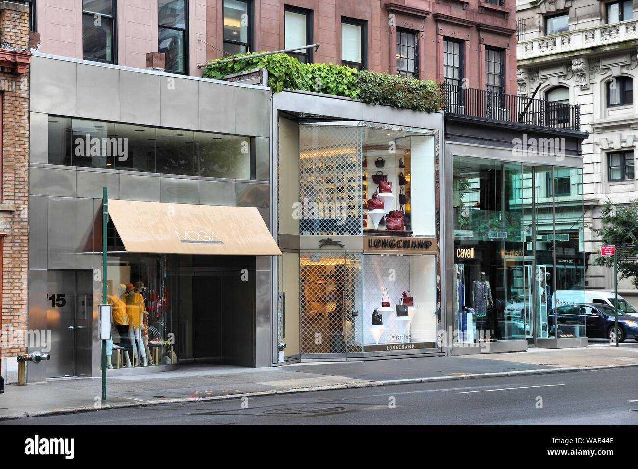 NEW YORK, USA - JULY 1, 2013: Stores along Madison Avenue in New York. Madison Avenue is one of the most recognized fashion shopping destination in th Stock Photo