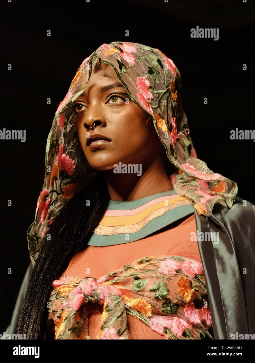 Designer Muhire showcases work on the catwalk at the Africa Fashion Week held at the Freemason's Hall, London. Stock Photo