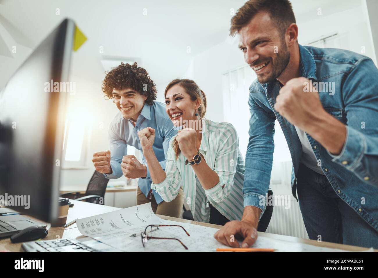 Young Successful Business People Celebrating Success While Working On A New Project In The Casual Office Stock Photo Alamy