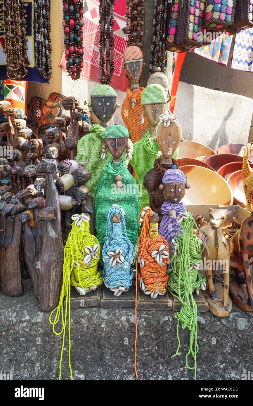 African goods or souvenirs for sale at a street vendor stall at a market in Mpumalanga,South Africa items such as beaded dolls,wooden carved animals Stock Photo
