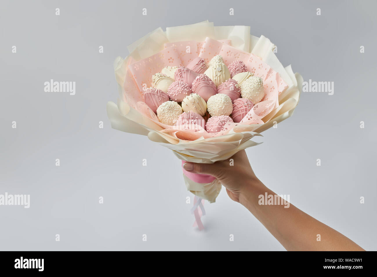 Beautiful Tender Bouquet Consisting Of Ripe Strawberries Covered With White And Pink Chocolate In A Hand Of Woman Stock Photo Alamy
