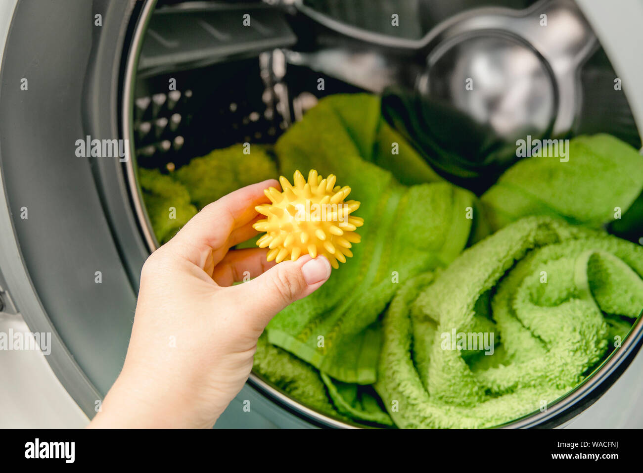 Using pvc dryer balls is natural alternative to both dryer sheets and liquid fabric softener, balls help prevent laundry from clumping in the dryer. Stock Photo