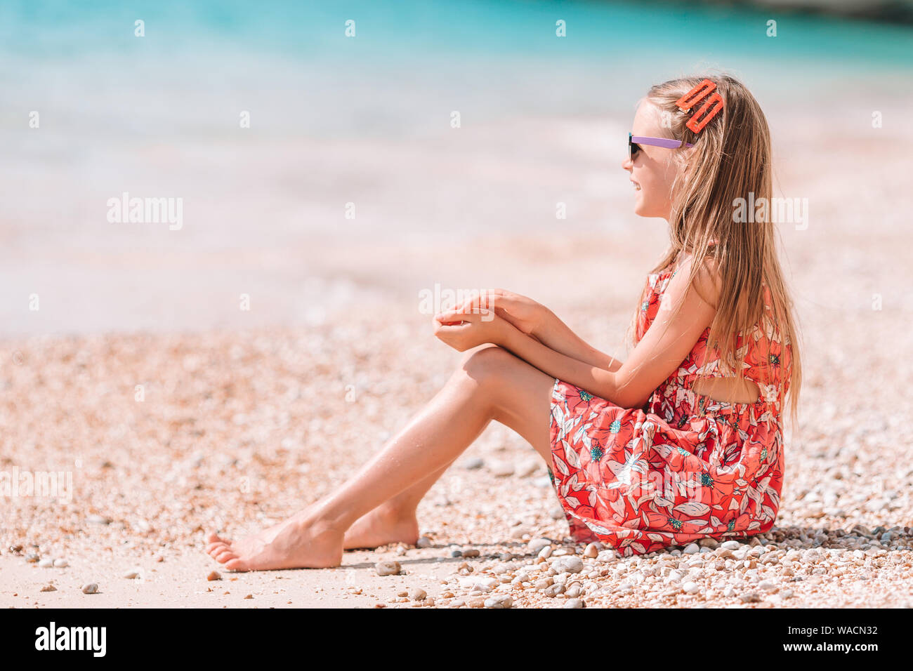 Cute little girl at beach during summer vacation Stock Photo