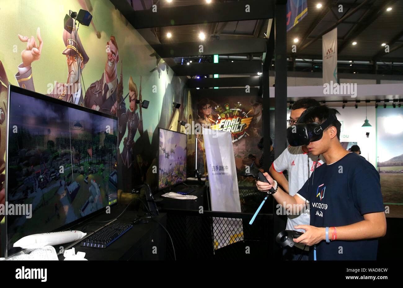 A visitor tries out a VR device to compete in the e-sports
