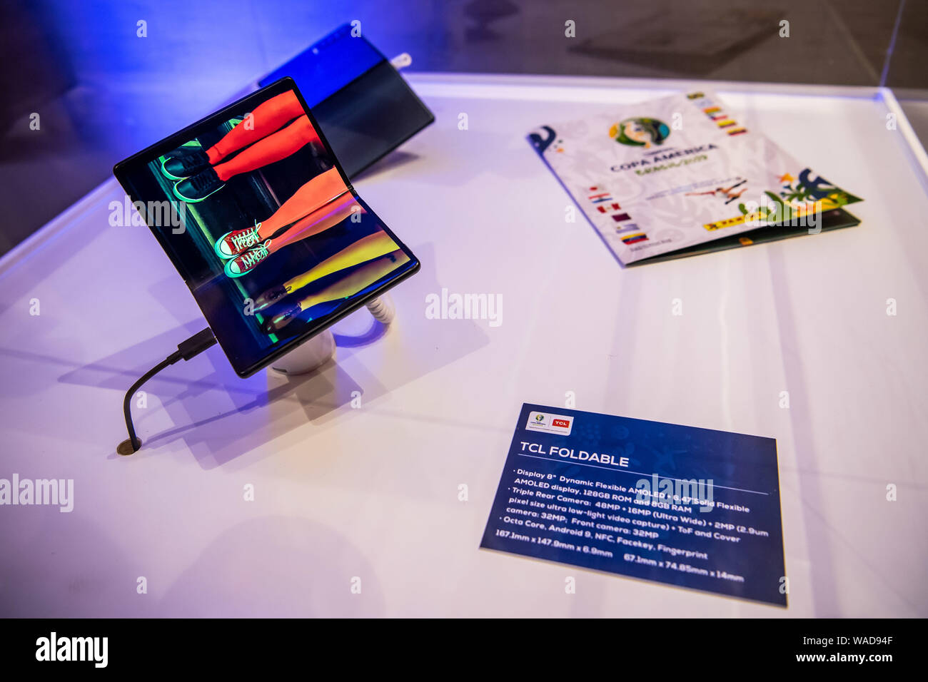 A TCL 5G Foldable smartphone is displayed during the TCL new
