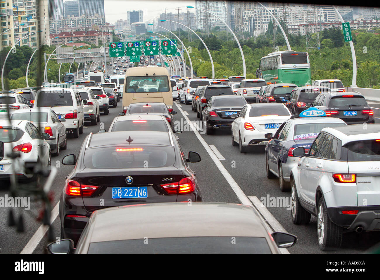 FILE--Cars move slowly on a road in a traffic jam during